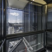 In the EMA building lift well and stair architecture, building, glass, house, window, black
