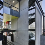 The externalised stairs and lift column delineate the architecture, building, facade, glass, house, interior design, gray, black