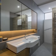 Under-lit mirror cabinets provide ample storage in this architecture, bathroom, floor, interior design, room, sink, gray