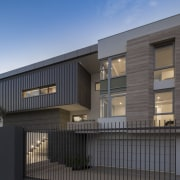 This home's generous six-car garage is accessed directly architecture, building, commercial building, elevation, facade, home, house, property, real estate, residential area, siding, black, gray, teal