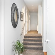 From this home's side entry, the interior steps ceiling, floor, flooring, home, interior design, wall, white
