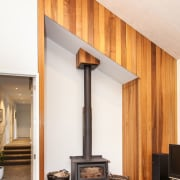 On this home by Dwelling Architectural Design, the ceiling, floor, flooring, furniture, hearth, interior design, wall, wood, white