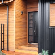 On this home by Dwelling Architectural Design, the door, facade, home, house, real estate, siding, window, wood, wood stain, orange