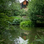 Upon reflection – with super-efficient glazing and heating bank, bayou, biome, flower, garden, grass, green, house, landscape, leaf, nature, nature reserve, plant, pond, reflection, riparian zone, river, tree, vegetation, water, water resources, watercourse, waterway, wetland, green, brown