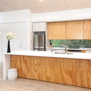 Affordable in white laminate and plywood, this kitchen cabinetry, countertop, floor, flooring, furniture, hardwood, interior design, kitchen, real estate, wood, wood flooring, white, orange