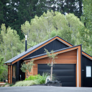Fresh angle – this home by house designer cottage, farmhouse, home, house, log cabin, plant, real estate, shed, siding, tree, green, black