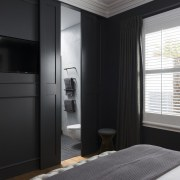 In this master suite makeover, the bedroom's custom architecture, ceiling, interior design, room, window, black, gray