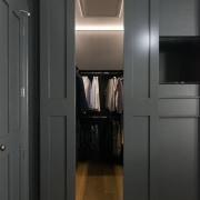 Open sesame – dark grey wall panelling disguises cabinetry, closet, door, floor, interior design, room, black