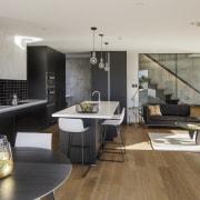 On this new kitchen project, the kitchen is architecture, floor, flooring, house, interior design, interior designer, living room, loft, gray, black