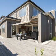 A mix of horizontal and vertical run cladding cottage, elevation, facade, home, house, property, real estate, residential area, siding, white