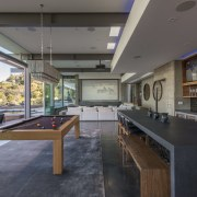 The dropped ceiling in this large, poolside entertaining interior design, real estate, table, gray, black