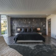 The original master bedroom has been retained in architecture, bedroom, ceiling, floor, house, interior design, real estate, room, wall, gray, black