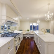 This kitchen renovation by award-winning designer Kira Gray ceiling, countertop, estate, home, interior design, kitchen, real estate, room, gray