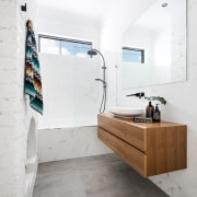 An existing fireplace was retained in this new architecture, bathroom, floor, flooring, home, interior design, product design, room, sink, tap, tile, wall, white