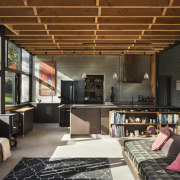 The kitchen sits beneath the mezzanine level at house, interior design, living room, loft, black, brown