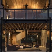 Mezzanine spaces sit at both ends of the architecture, home, interior design, lighting, lobby, black, brown