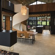 A grand central space in this home by flooring, furniture, interior design, lobby, table, black, brown