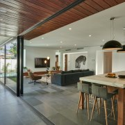 This kitchen's wood veneer cabinetry connects with the ceiling, house, interior design, real estate, gray
