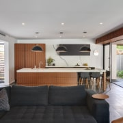 Breathing space between cabinetry elements helps avoid this interior design, living room, real estate, gray