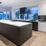The look is refined and simple on this countertop, floor, interior design, kitchen, gray