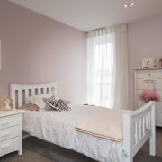 The owners' children chose the paint tones for bed, bed frame, bed sheet, bedding, bedroom, chest of drawers, floor, furniture, home, interior design, mattress, product, property, real estate, room, wall, window, wood, gray