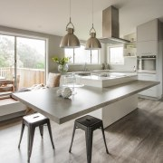 This generous-sized family kitchen by architect Mona Quinn countertop, cuisine classique, dining room, floor, flooring, furniture, interior design, kitchen, room, table, gray