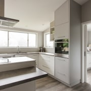 This large scullery in a kitchen by Callidus cabinetry, countertop, cuisine classique, interior design, kitchen, real estate, gray
