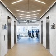 Broad corridors and feature wood drop ceilings are ceiling, daylighting, floor, flooring, white, brown