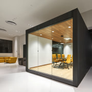 The box-like conference room at Supplyframe DesignLab protrudes architecture, ceiling, house, interior design, lobby, real estate, gray