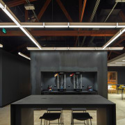 The dark and moody setting at Supplyframe DesignLab architecture, ceiling, daylighting, interior design, black