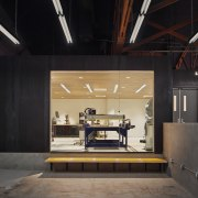 The engineering shop at Supplyframe DesignLab was inserted architecture, ceiling, interior design, lobby, black