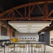 Supplyframe DesignLab's building envelope retains the original brickwork architecture, ceiling, daylighting, interior design, lobby, roof, black, gray