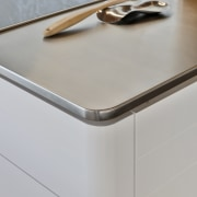 A slender stainless steel top provides an ideal product design, table, gray