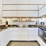 The slender stainless steel from the kitchen's cooking cabinetry, countertop, cuisine classique, interior design, kitchen, real estate, white