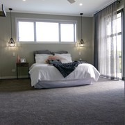 The master bedroom in this Fowler Homes Orewa architecture, bed frame, bedroom, ceiling, floor, room, gray, black