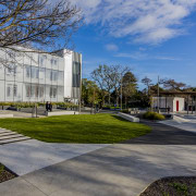 Both the Hutt Council's administration building and its architecture, building, campus, city, condominium, corporate headquarters, daytime, estate, facade, grass, headquarters, home, house, landscape, mixed use, neighbourhood, plant, plaza, real estate, residential area, sky, suburb, tree, urban design, gray, teal