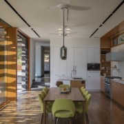 A patterned aluminium trellis outside this kitchen throws architecture, ceiling, dining room, house, interior design, kitchen, loft, real estate, gray, brown