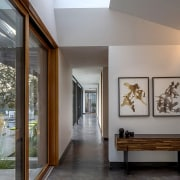 Accessed from the entranceway, the long arm of architecture, ceiling, daylighting, home, house, interior design, gray