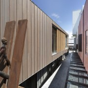 A feature of The Crossing is artist Paul architecture, building, gray