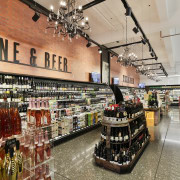 Freshchoice supermarket is situated on the streetside of liquor store, retail, gray