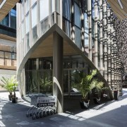 The hospitality building with its distinctive facade stands architecture, mixed use, white, black