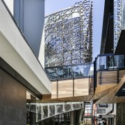 Cheers! The central hospitality building at The Crossing architecture, building, mixed use, black
