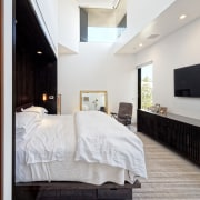 A clerestory window high on the 5.5m-high front bed, bed frame, bedroom, ceiling, floor, flooring, furniture, home, interior design, real estate, room, suite, wood, gray, white
