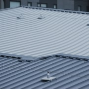 A KingZip SF standing-seam interlocking roof system was architecture, daylighting, roof, structure, gray, blue