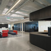 In a fit-out that's about inclusivity and transparency, ceiling, interior design, lobby, office, gray, black