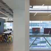 A shaped display screen matches the curved nature architecture, ceiling, daylighting, glass, interior design, gray