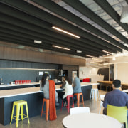 Acoustic beams suspended above the Z Energy office cafeteria, institution, interior design, table, black