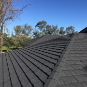 A brand new roof daylighting, outdoor structure, roof, roofer, sky, gray, black, blue