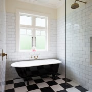 Black and white floor tiles create a strong architecture, bathroom, ceiling, daylighting, floor, flooring, home, interior design, plumbing fixture, room, tile, wall, gray, white