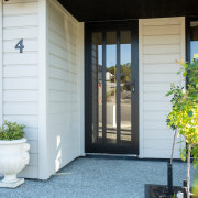 Entrance To Modern Envira Rusticated Weatherboard Home architecture, door, facade, home, house, porch, real estate, siding, window